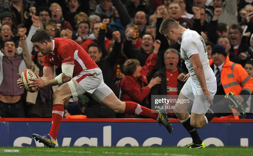Wales's wing Alex Cuthbert (L) runs in to score Wale's first try during the Six Nations international rugby union match between Wales and England at the Millennium Stadium in Cardiff, south Wales on March 16, 2013.