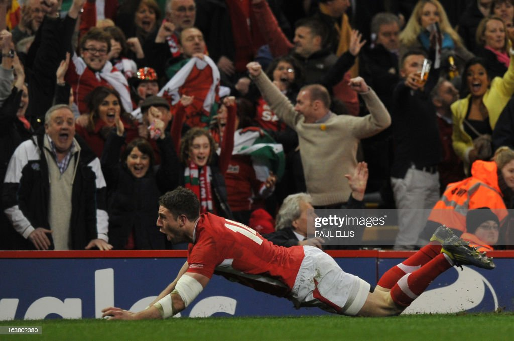 Wales's wing Alex Cuthbert scores Wale's first try during the Six Nations international rugby union match between Wales and England at the Millennium Stadium in Cardiff, south Wales on March 16, 2013.