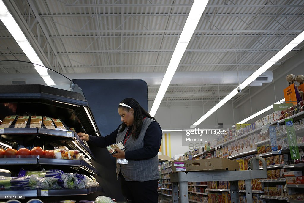 Walgreen Co. Assistant Store Manager Tammy Jenkins stocks sandwiches at one of the company's stores in Louisville, Kentucky, U.S., on Monday, Sept. 30, 2013. Walgreen Co., the biggest U.S. drugstore chain, is expected to report fourth-quarter earnings before the opening of U.S financial markets on Oct. 1. Photographer: Luke Sharrett/Bloomberg via Getty Images