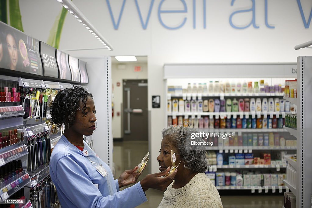 Walgreen Co. employee Shanta Cook, left, helps customer Anna Board pick cosmetics at one of the company's stores in Louisville, Kentucky, U.S., on Monday, Sept. 30, 2013. Walgreen Co., the biggest U.S. drugstore chain, is expected to report fourth-quarter earnings before the opening of U.S financial markets on Oct. 1. Photographer: Luke Sharrett/Bloomberg via Getty Images