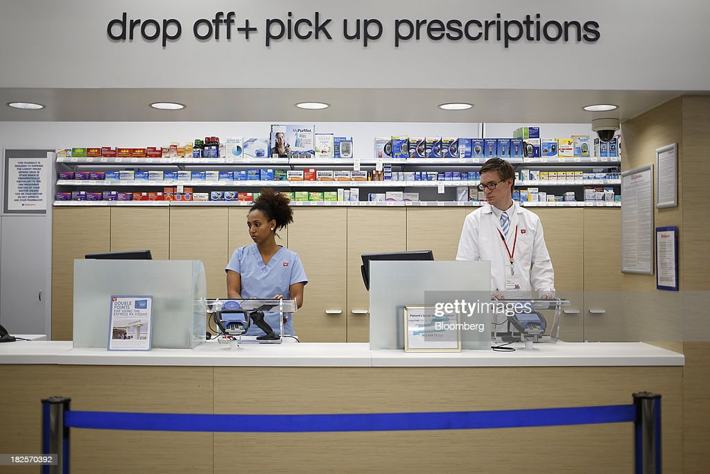 Walgreen Co. pharmacy employees work on computers while waiting for customers at one of the company's stores in Louisville, Kentucky, U.S., on Monday, Sept. 30, 2013. Walgreen Co., the biggest U.S. drugstore chain, is expected to report fourth-quarter earnings before the opening of U.S financial markets on Oct. 1. Photographer: Luke Sharrett/Bloomberg via Getty Images