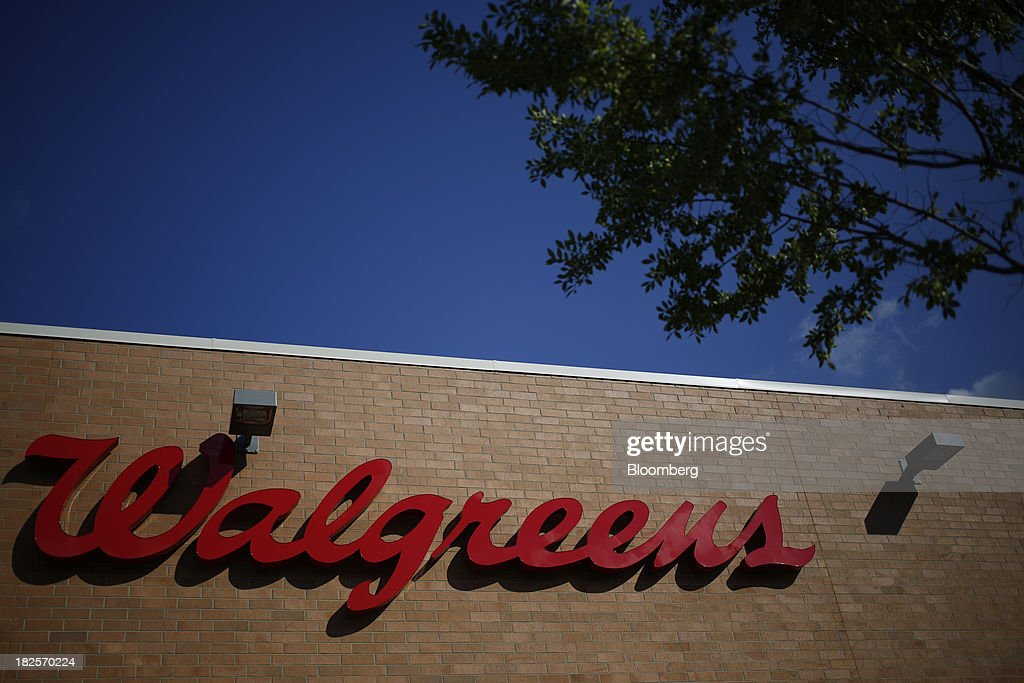 Walgreen Co. signage is displayed outside one of the company's stores in Louisville, Kentucky, U.S., on Monday, Sept. 30, 2013. Walgreen Co., the biggest U.S. drugstore chain, is expected to report fourth-quarter earnings before the opening of U.S financial markets on Oct. 1. Photographer: Luke Sharrett/Bloomberg via Getty Images
