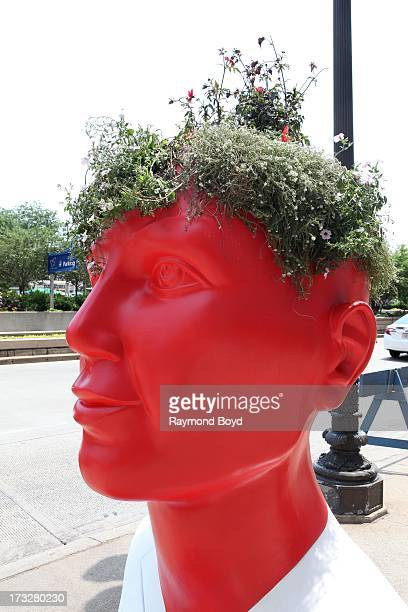 Walgreen'ssponsored lifesized head shaped planter sculpture built from recycled aluminum steel and concrete materials are displayed along the Chicago...