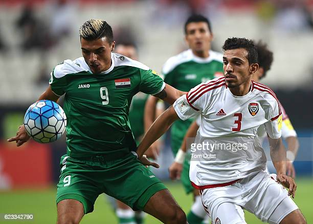 Walid Abbas of UAE and Ahmed Yasin of Iraq in action during the 2018 FIFA World Cup Qualifier match between UAE and Iraq at Mohamed Bin Zayed Stadium...