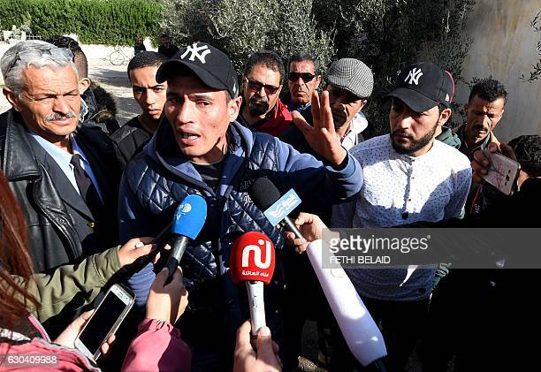Walid and Abdelkader Amri the brothers of 24yearold Anis Amri the prime suspect in Berlin's deadly truck attack talk to the media in front of their...