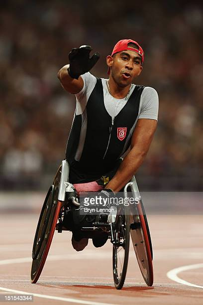 Walid Ktila of Tunisia celebrates winning gold in the Men's 100m T34 Final on day 10 of the London 2012 Paralympic Games at Olympic Stadium on...