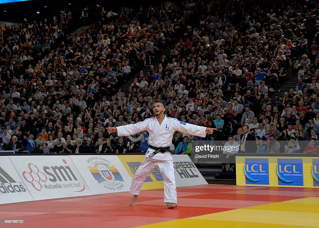 Walide Khyar of France happily dances around in front of the ten thousand mainly French audience after winning the u60kg bronze medal during the 2016...