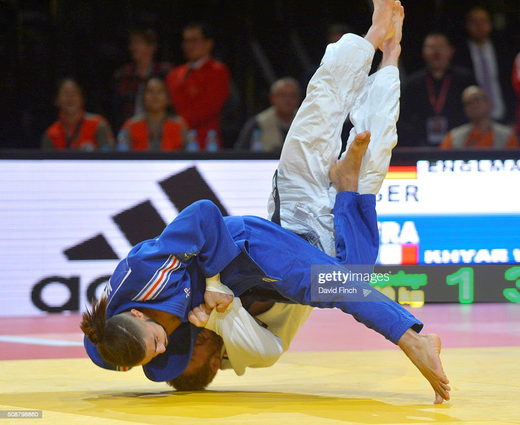 Walide Khyar of France throws Tobias Englmaier of Germany for an ippon with an inner thigh throw to win their u60kg repercharge contest and...