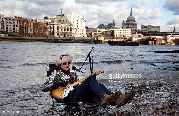 A walk along the River Thames on the Southbank in London A busker called the 'Flame Proof Moth' performs on the edge of the River Thames with St...