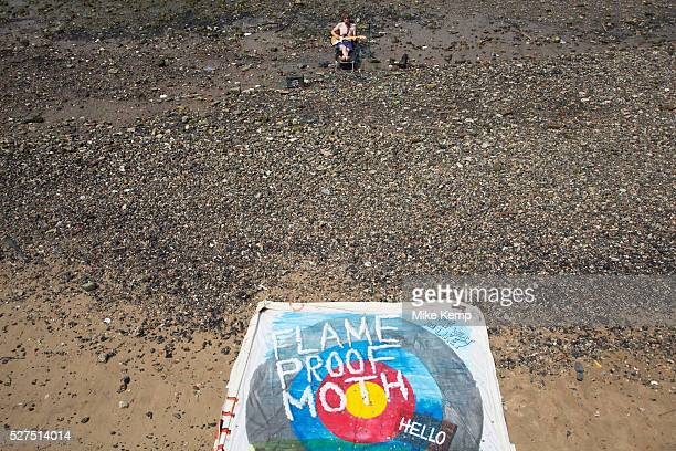 A walk along the River Thames on the Southbank in London A busker called the 'Flame Proof Moth' performs on the edge of the River Thames Playing an...