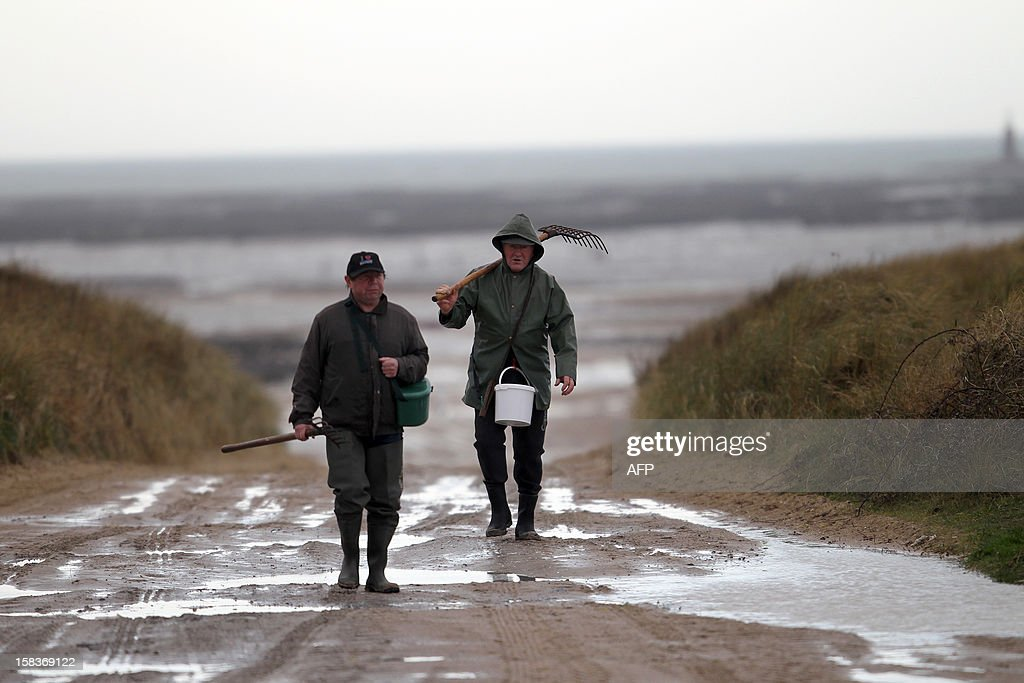 Walk fishermen are back from fishing on December 14, 2012, in Agon-Coutainville, northwestern France.