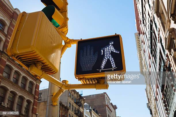 Walk sign at pedestrian walkway in Soho, New York