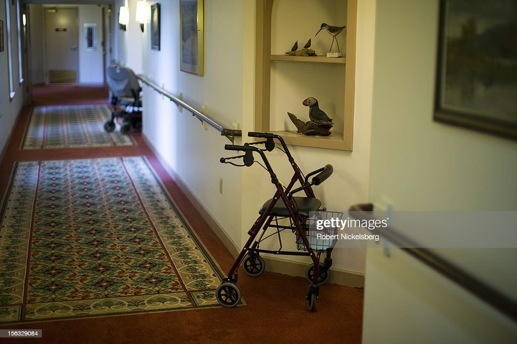 A walker and an electric wheelchair are left outside residences at an assisted living facility November 10, 2012 in Connecticut.