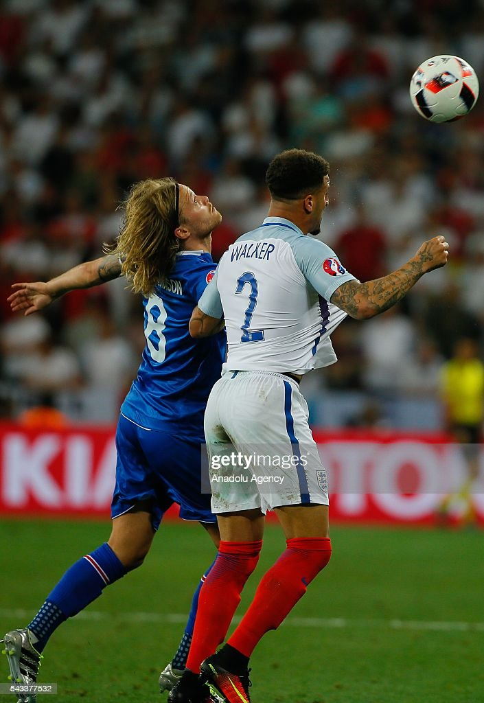 Walker (2) of England in action against Bjarnason (8) of Iceland during the UEFA Euro 2016 Round of 16 football match between Iceland and England at Stade de Nice in Nice, France on June 27, 2016.