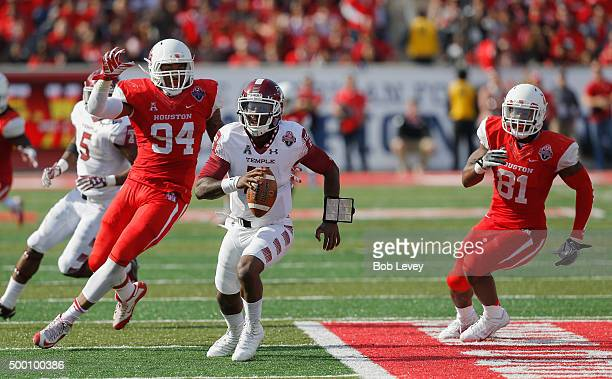 J Walker of the Temple Owls avoids being sacked by Cameron Malveaux of the Houston Cougars and Tyus Bowser in the fourth quarter at TDECU Stadium on...