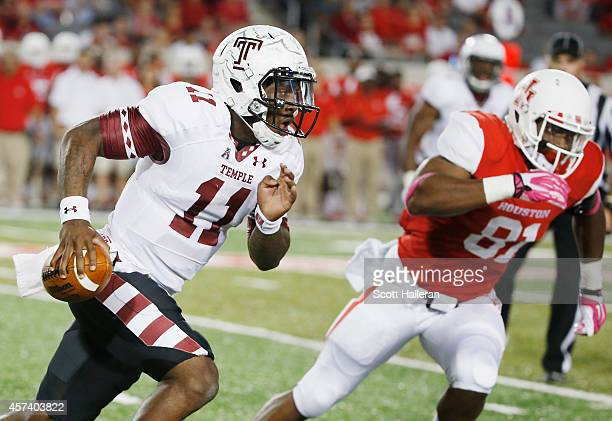 J Walker of the Temple Owls scrambles past Tyus Bowser of the Houston Cougars in the first half of their game at TDECU Stadium on October 17 2014 in...