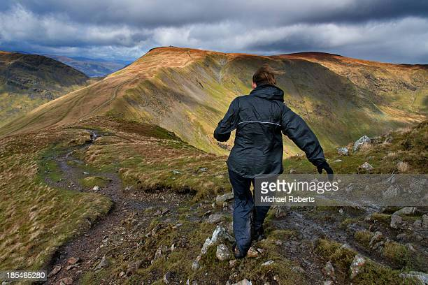 Walker on Kentmere horseshoe in Lake District