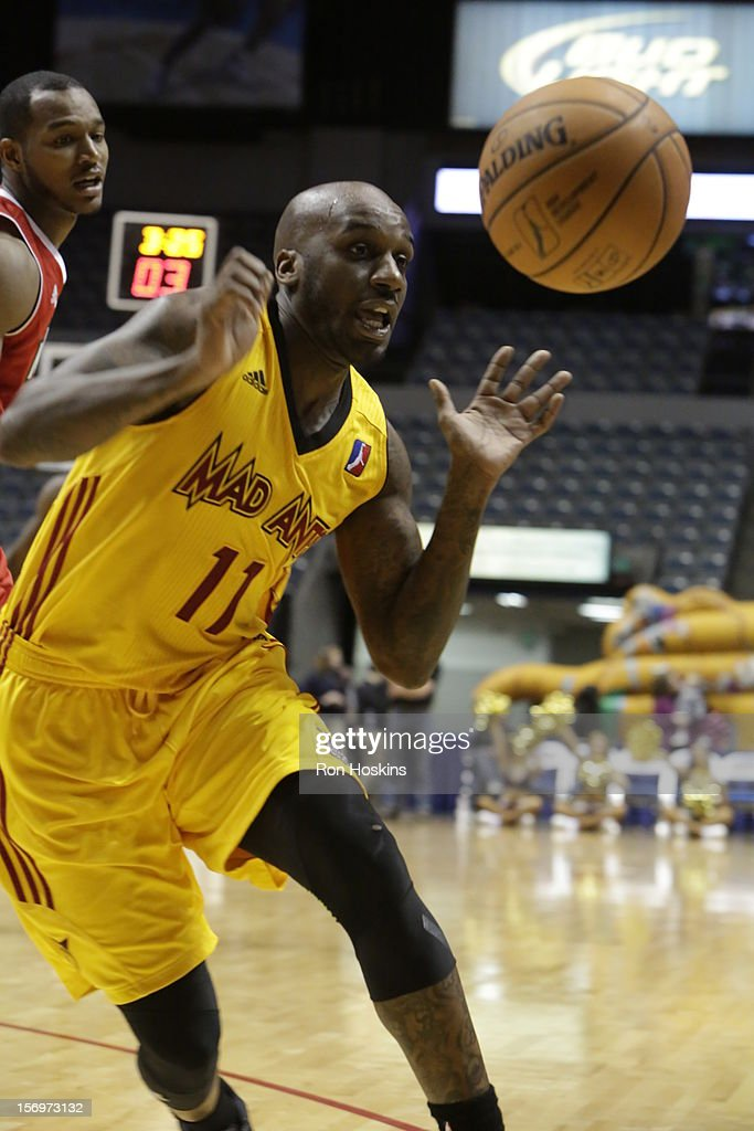 Walker Russell Jr. #11 of the Fort Wayne Mad Ants battles a Maine Red Claws defender at Allen County Memorial Coliseum on November 25, 2010 in Fort Wayne, Indiana.