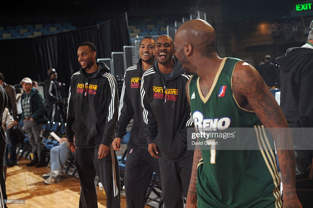 Walker Russell #7 of the Reno Bighorns shares a laugh with former Fort Wayne Mad Ant teammates following his game against the Springfield Armo during the 2013 NBA D-League Showcase on January 7, 2013 at the Reno Events Center in Reno, Nevada.
