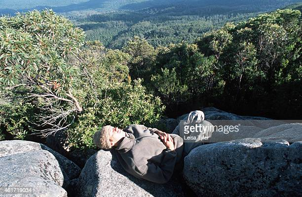 FORESTS TASMANIA AUSTRALIA A walker sleeps overlooking the Tarkine the largest tract of temperate rainforest in the world Containing a rare red...