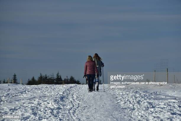Walkers between ground and sky in winter
