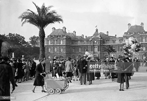 Walkers in front of the Senate in the Luxembourg Gardens in Paris October 20 1938