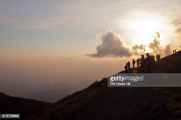 Walkers on a ridge at Pacaya an active volcano in Guatemala near the old Colonial capital city of Antigua in the Escuintla Department It is a popular...