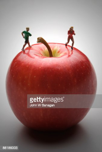 walkers on apple : Stock Photo