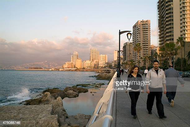 Walkers on Beirut's Corniche a spacious palm fringed boardwalk that hugs the sides of the Mediterranean All of Beiruts denizens come to promenade in...