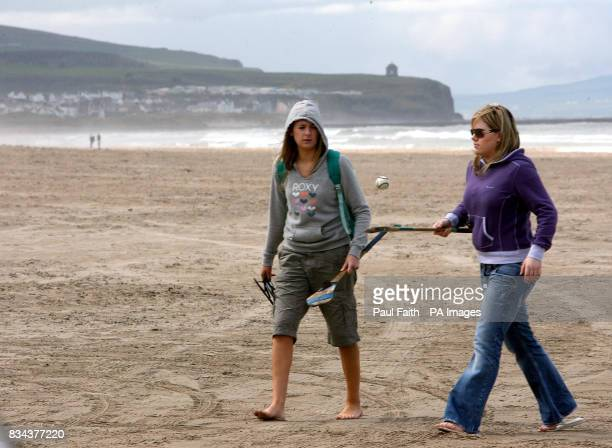 Walkers on Portstewart Strand Co Derry where a new visitor centre has been opened