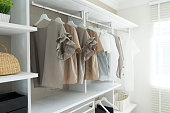 white walk-in wardrobe with cloth hanging