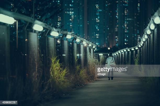 Walking alone on pathway in dark