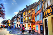 Walking along the river with colourful buildings in Colmar Alsace in France
