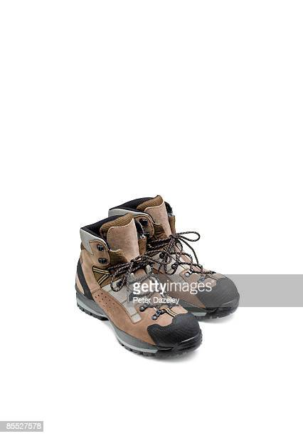 Walking boots on white background.