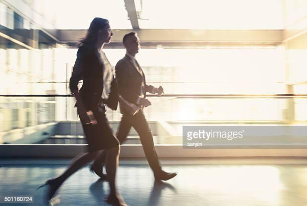 Walking business couple