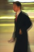 Walking businessman, side view, blurred motion, New York City, NY, USA