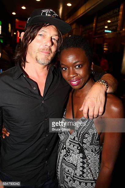 'Walking Dead' stars Norman Reedus and Danai Gurira pose at the hit play 'Eclipsed' on Broadway at The Golden Theatre on May 27 2016 in New York City