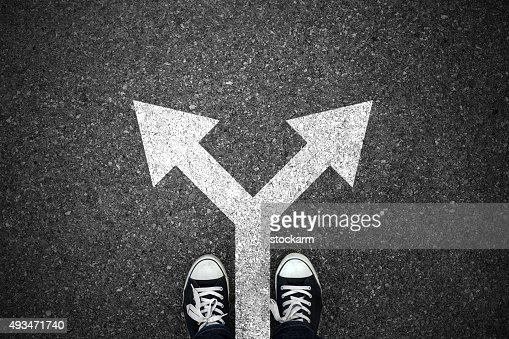 Walking direction on asphalt : Stock Photo