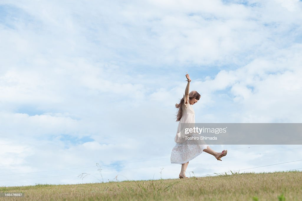 A walking girl : Stock Photo