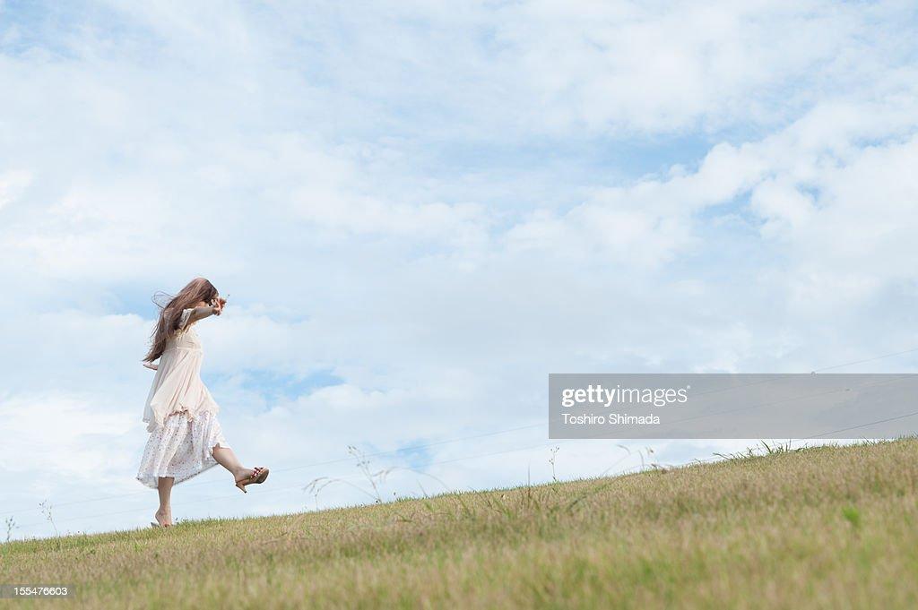 A walking girl : Stock Photo