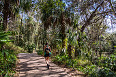 Woman on a trail near Rainbow Springs, Florida. Gulf Coast States.