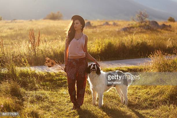 Walking in the summertime nature with a shepherd dog