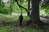 Taking a healthy walk in woodland on a dull day in Carshalton, Surrey.