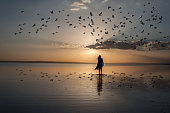 Young woman walking at sunset over Salt Lake,Turkey.