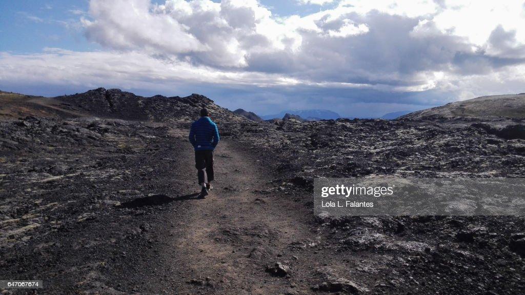 Walking on a lava field : Foto de stock