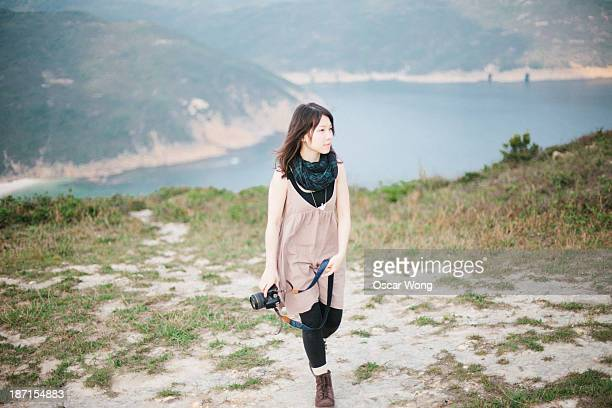 Walking on a mountain with camera