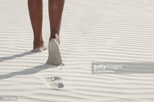 Walking on a white sand beach.