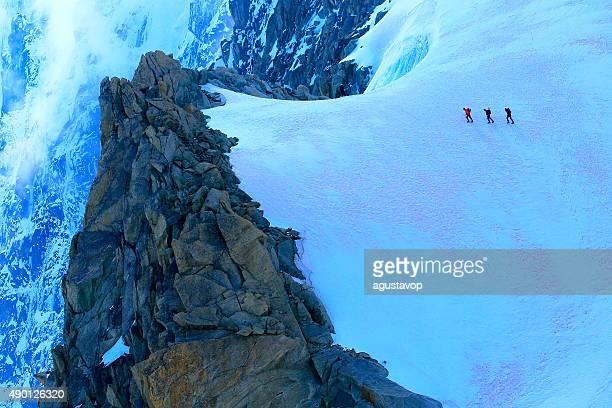 Walking on ice: Mont Blanc tiny hikers, alpine glacier – Chamonix