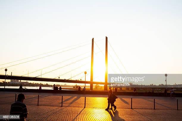 Walking on promenade in sunset