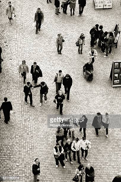 Walking people Aerial view Prague Charles Bridge